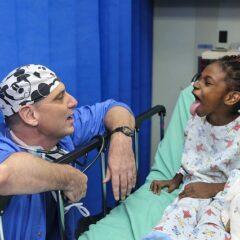 Doctor with child Epiglottitis